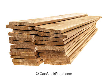 Wooden cedar boards piled - Stacks of one by six inch cedar ...