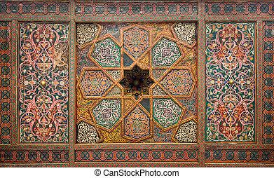 Wooden ceiling, oriental ornaments from Khiva, Uzbekistan