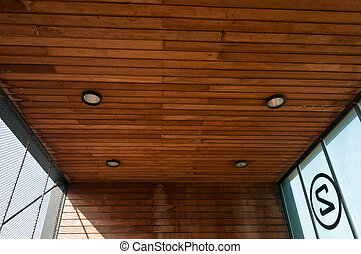 wooden ceiling with round lights