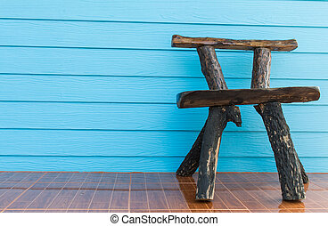 wooden chair and blue wall background