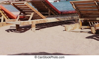 wooden chair at the beach of background of blue sea