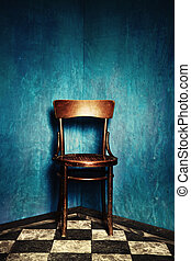 chair in corner - wooden chair in corner of grunge room with...