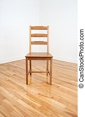 Wooden chair in the corner of a room