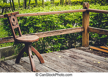 wooden chair in the garden: vintage tone