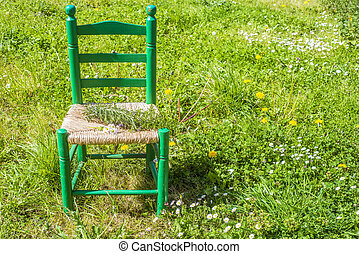 Wooden chair in the meadow