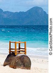 wooden chair on a beach