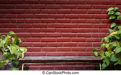 Wooden chair on a brick wall