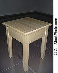Wooden chair on dark background