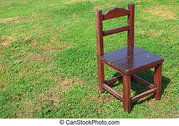 Wooden chair on the lawn