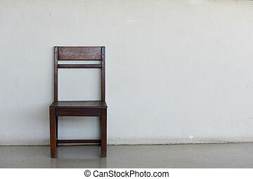 Wooden chair on the wall background.