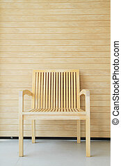 Wooden chair with wooden wall in background