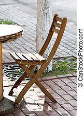 wooden chairs close-up in a street cafe