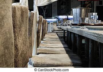 wooden chairs near the served table