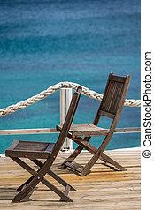 Wooden chairs on a deck platform