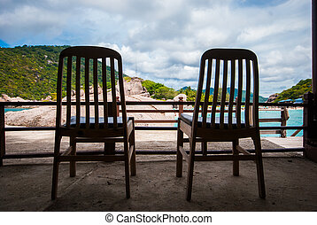 Wooden chairs on the beach