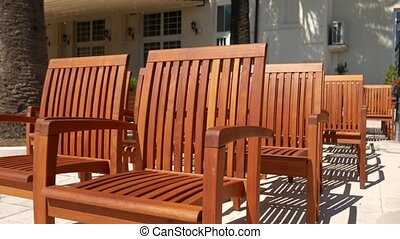 Wooden chairs on the street. Chairs for cafe