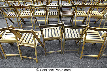 Wooden chairs, rows of chairs in a visual spectacle