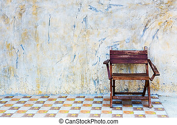 Wooden chairs with old plaster walls