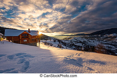 wooden chalet in deep snow at sunrise - wooden chalet in...