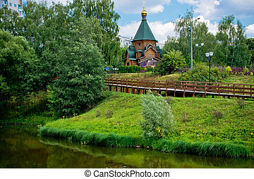 wooden chapel on the shore of a river
