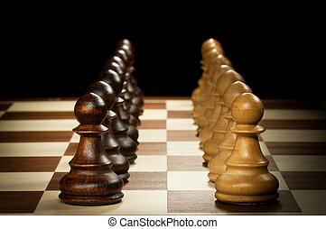 wooden chess pawn - chess pieces isolated on a black...