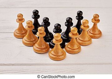 Wooden chess set on white background.