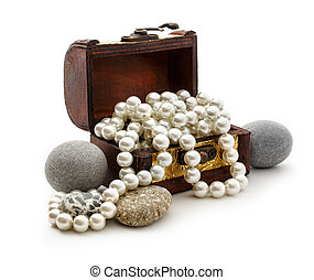 Wooden chest with white pearl necklace and sea stones