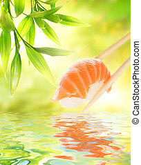 Wooden chopsticks holding salmon sashimi reflected in water