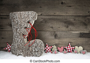 Wooden christmas background in red and grey with santa boot....