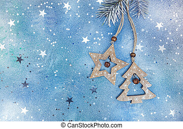 wooden christmas decorations on glittery blue background