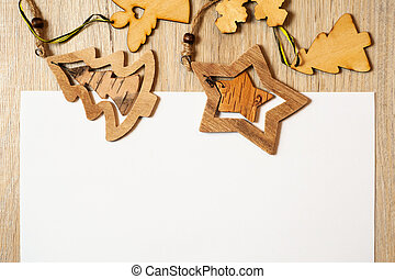 Wooden Christmas toys on a white background with place for text