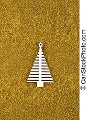 Wooden Christmas tree shape on golden glitter background