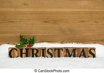 Wooden Christmas Word with holly and snow