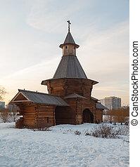 wooden church at sunset