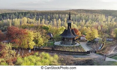 Chisinau, Moldova - circa October 2019: usual day near wooden Church of the Assumption of the Blessed Virgin Mary built in very nice place at the edge of Chisinau city