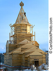 Wooden church under construction on the blue sky background