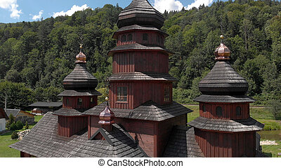 Wooden church with shiny domes.