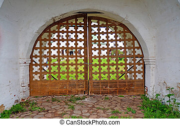 Wooden closed gates at the church