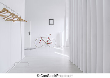 Wooden clothes hangers in hall