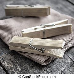 wooden clothes pegs on the wooden table in close up