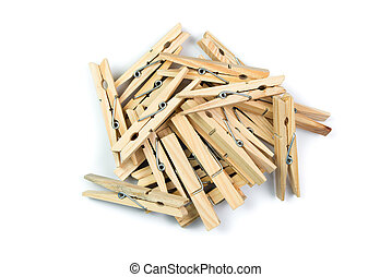 Wooden clothes pegs - Pile of wooden clothes pegs over white...
