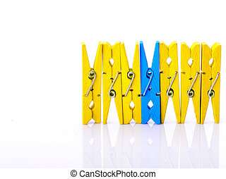 wooden clothes pins on a white background