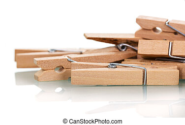 Wooden clothespins close-up isolated on white.