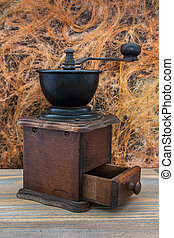 Wooden coffee grinder.