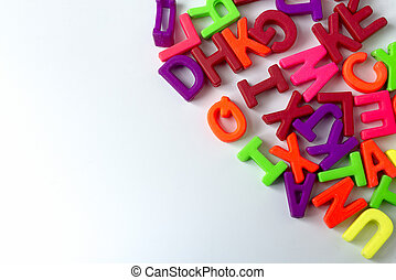 Wooden colored letters on a white background.