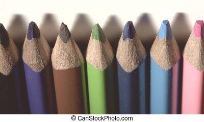 Wooden colored pencils close-up pan shot