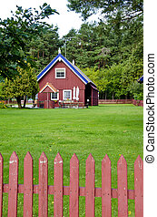 Wooden colorful house well fence rural homestead