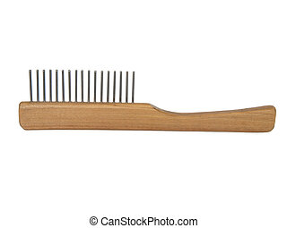 Wooden comb for a dog or cat with metal prongs, isolated on the white background