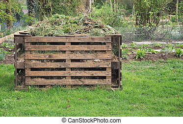 wooden composter for organic waste in a garden