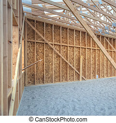 Wooden construction of building in sand pit square